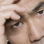 Man Holding Forehead --- Image by © Royalty-Free/Corbis